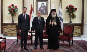 Bashar al-Assad with Vladimir Putin (centre) and Patriarch John X of Antioch, January 2020.