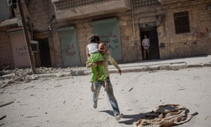 'You have to take care of your head and your heart after witnessing terrible things' … a father runs out of his apartment carrying his daughter following airstrikes in Aleppo, Syria in 2012.