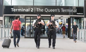 Police officers on patrol at Heathrow airport.