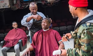 Pub and political platform, social centre and soapbox … Peter Bankolé as Kwabena, Cyril Nri as Emmanuel, Abdul Salis as Kwami and Fisayo Akinade as Samuel in Barber Shop Chronicles by Inua Ellams at the National Theatre.