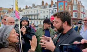 Ukip's Carl Benjamin is confronted by a protester in Weymouth, Dorset on 17 May.