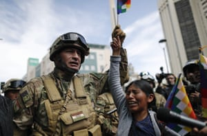 A woman cries in front of soldiers during a march by supporters of former president Evo Morales in downtown La Paz, Bolivia.