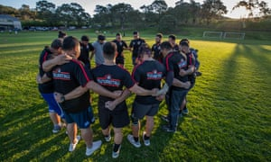 Members of the Tu'uakitau Ha'apai Rugby Team from Tonga say a prayer together before training on the field at Mangere Mountain.