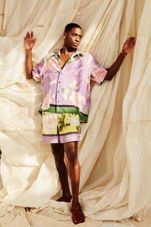 Floral shirt and shorts both valentino.com. Tan sandals, grenson.com.