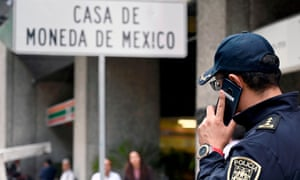 A policeman outside Casa de Moneda in Mexico City after it was robbed of $2.5m in gold coins.