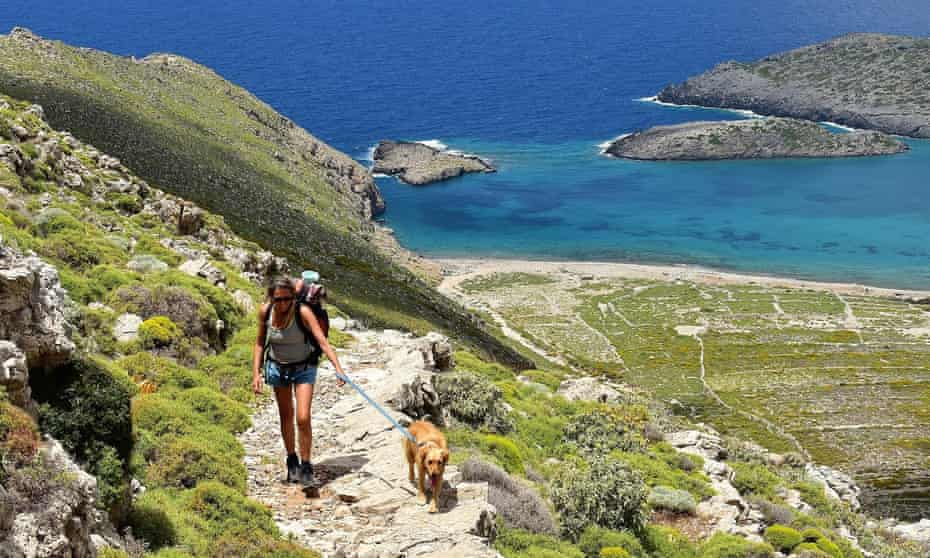The writer and her dog on the way up from Tristomo, Karpathos.