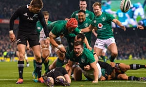 Jacob Stockdale (centre) celebrates Ireland's first try during November's victory over No 1-ranked side New Zealand in Dublin.