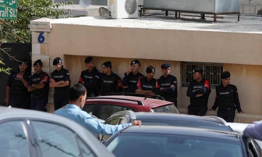 Police stand outside a hospital in Amman, Jordan