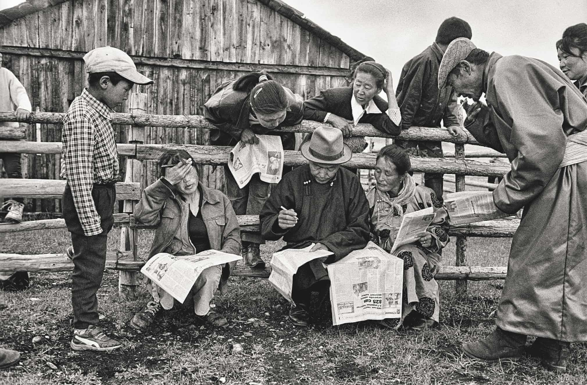 The voters in a small village near lake Khövsgöl prepare lottery coupons for a draw, solving a crossword, after a meeting with the opposition leader Lamjavyn Gündalai, during the electoral campaign in 2004. Mongolia, 2004