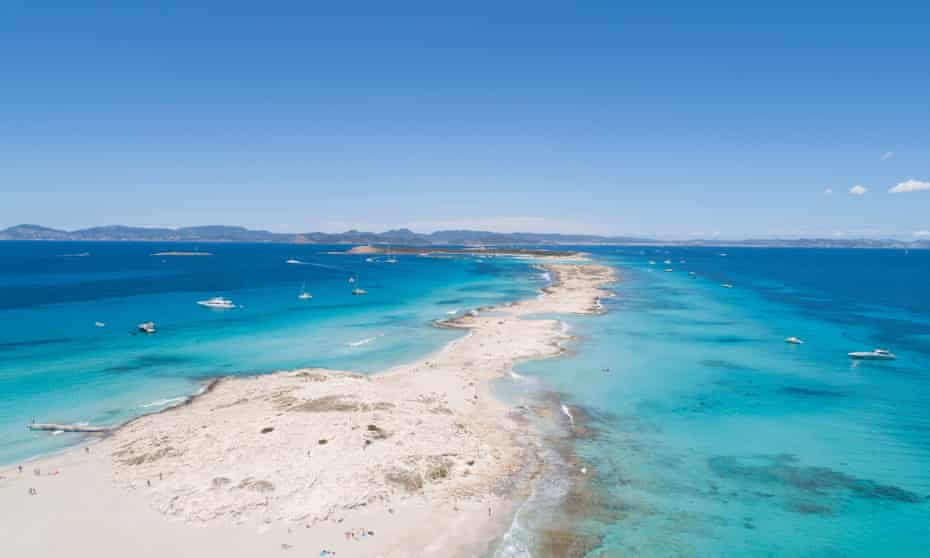 illetas, formentera beach seen from drone with turquoise and crystalline sea and Ibiza in the background