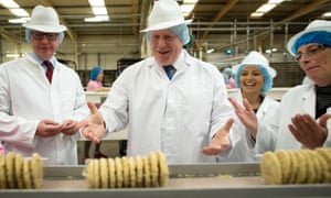 (From the left) Michael Gove, Boris Johnson and Priti Patel during a visit to Farmhouse Biscuits in Nelson, Lancashire.