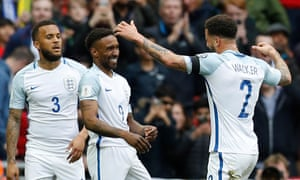 Jermain Defoe (centre) celebrates with Ryan Bertrand (left) and Kyle Walker after his opening goal for England against Lithuania.