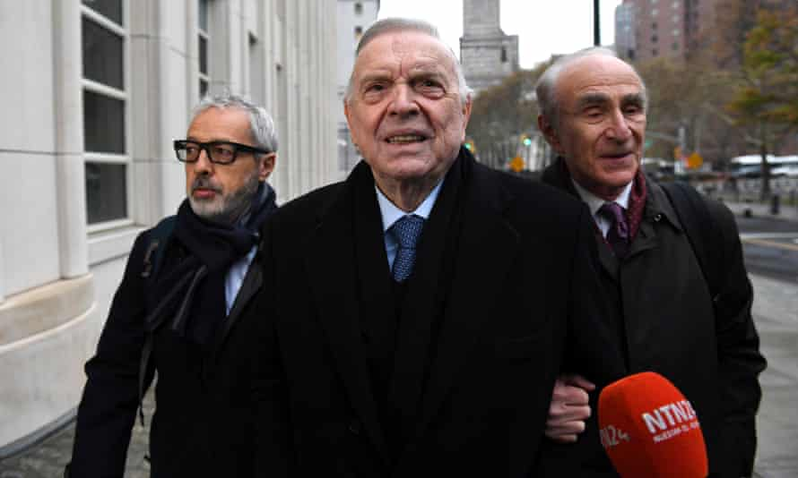 José Maria Marin (centre) arrives for opening arguments at the Fifa bribery trial in Brooklyn on Monday