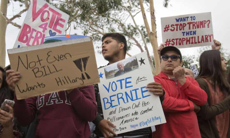 Supporters of US Democratic presidential candidate Bernie Sanders taunt Hillary Clinton supporters in Los Angeles.