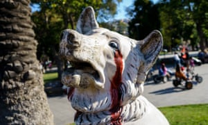 The bloody eye socket painted on to statues such as this dog in Plaza Victoria, Valparaíso, is a reminder of the more than 220 demonstrators who have lost an eye to rubber bullets shot by the police.