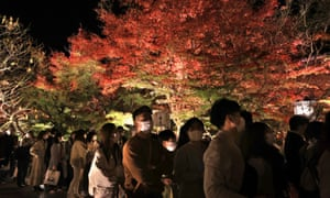 People enjoy illuminated autumn leaves at the Eikando temple in Kyoto on Saturday, 21 November 2020.