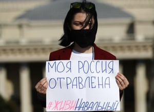 Novosibirsk, Russia: A woman holds a sign that reads: 'My Russia Is Poisoned. Navalny, Stay Alive'