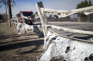 A fence melted by the Creek fire outside a ranch on Wentworth Street, Sunland