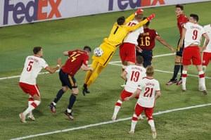 Poland's keeper Wojciech Szczesny misses a punch.
