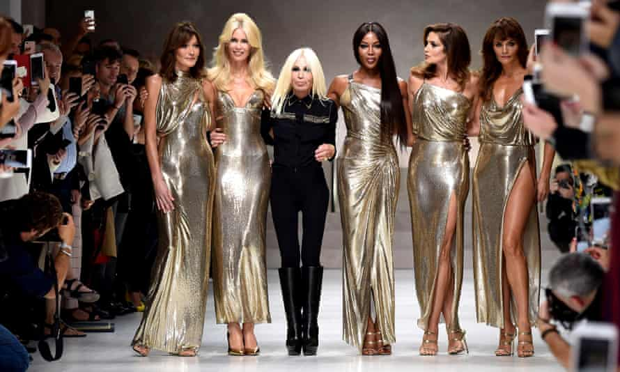 Carla Bruni, Claudia Schiffer, Naomi Campbell, Cindy Crawford, Helena Christensen and Donatella Versace walk the runway at the Versace show during Milan Fashion Week Spring/Summer 2018.