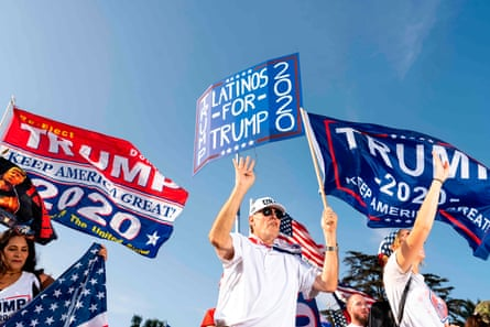 Donald Trump supporters hold during a rally in Beverly Hills, California, on Saturday.
