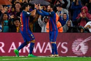 Barcelona's Lionel Messi, right, celebrates with fellow goalscorer Luis Suarez.
