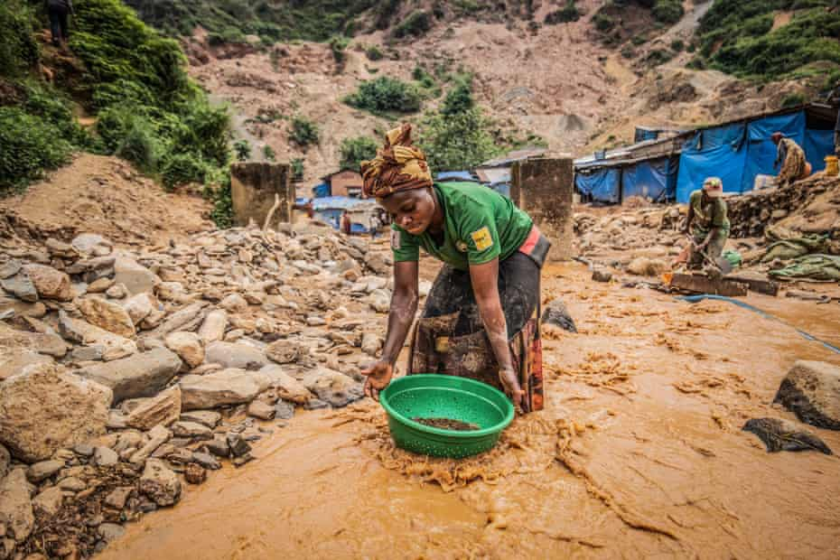 A woman pans for gold in Kamituga in DRC's South Kivu Province in March. Moses Sawasawa for Fondation Carmignac.