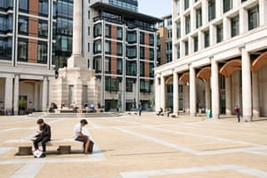 Workers in the formerly bustling Paternoster Square at lunchtime.