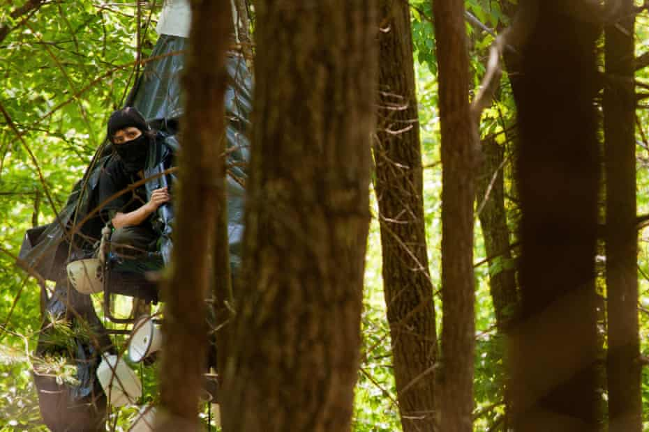 """Mountain Valley Pipeline protester """"Nutty"""" looks out from her monopod in the Virginia forest on her 49th day of continuous protest 45 feet above the ground."""