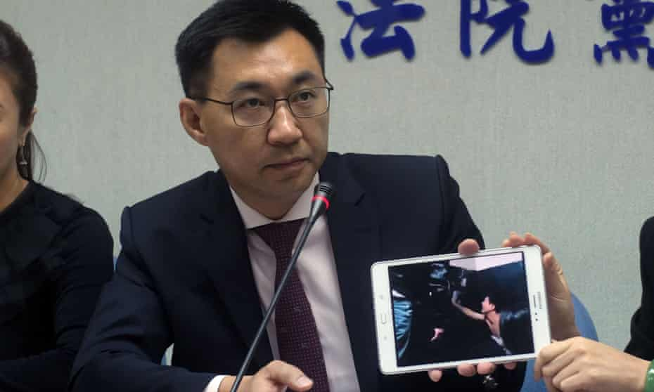 Johnny Chiang, from Taiwan's Kuomintang party, displays a video clip showing Taiwanese detained at a police station in Kenya, during a press conference in Taipei on 12 April.