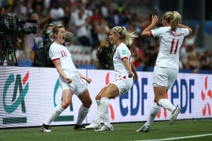 Ellen White of England celebrates with teammates after scoring her team's first goal.