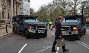 Armoured police personnel carriers on a street leading to the Houses of Parliament in central London on March 24, 2017