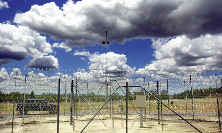 prison van patrolling outside a razor wire