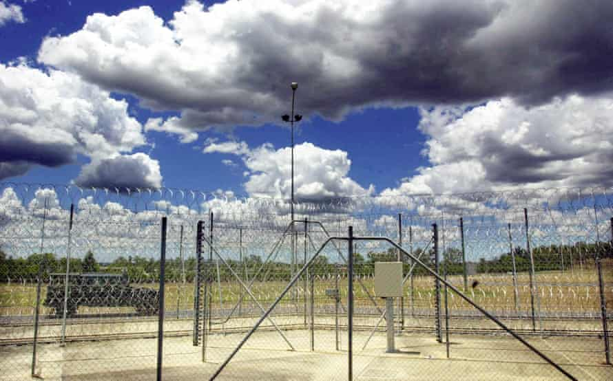 A prison van patrolling outside a fence at a Brisbane correctional centre