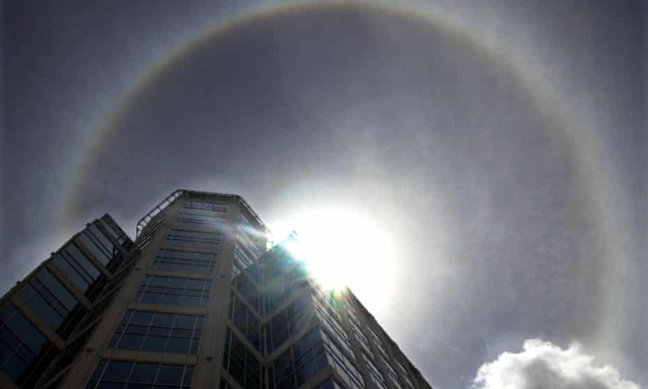 A ring around the sun, is seen over Fort Lauderdale, Fla., Friday, May 17, 2002. The halo is a rare effect on the sun caused by a layer of ice crystals in the atmosphere refracting light from the sun.