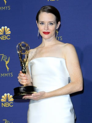 Claire Foy holds the Emmy for The Crown.