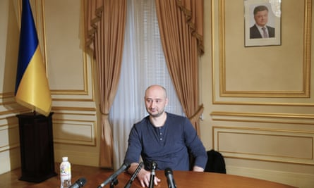 Russian journalist Arkady Babchenko speaks during an interview with foreign media