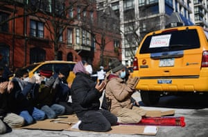 Yellow cab taxi drivers pray before joining a rally in New York City on 10 February, 2021. New York City taxi cab drivers held a day of action calling for debt forgiveness for loss of income amid work shortage due to the coronavirus pandemic.