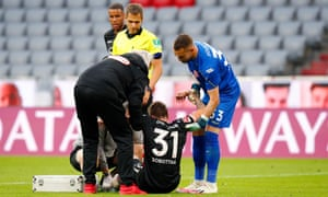 Marcel Sobottka of Fortuna Duesseldorf receives medical treatment.