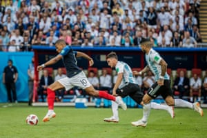 France's Kylian Mbappé glides away from Argentina's Nicolás Tagliafico and Éver Banega during the round of 16 match in Kazan.