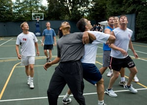 The president jostles with congressmen during a basketball game at the White House