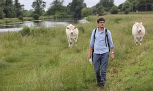 Patrick Barkham walking next to the river Great Ouse at Ely.