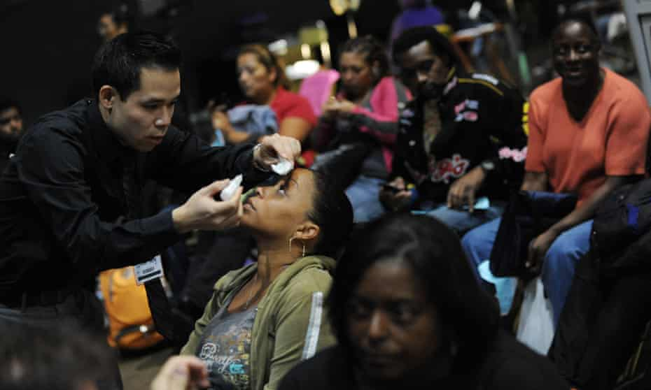 Problems in another country may seem soluble, but the complex problems of your own country deserve attention too. Here a woman receives eye drops from a volunteer medic, offering free medical, vision and dental services to those without health insurance and in need.