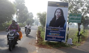 The billboard of Kamala Harris at the entrance to the village.