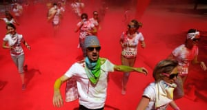 Moscow, RussiaParticipants race through clouds of colourful powder thrown by volunteers during the Colour Run at the Luzhniki Olympic Complex
