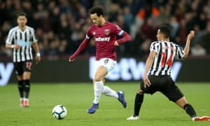 Felipe Anderson of West Ham skips past the tackle of Issac Hayden of Newcastle United.