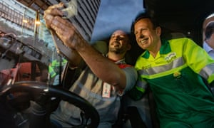 Doria poses for a selfie after clearing part of a city square in downtown São Paulo.