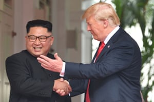 Smiles all around as Trump and Kim shake hands.