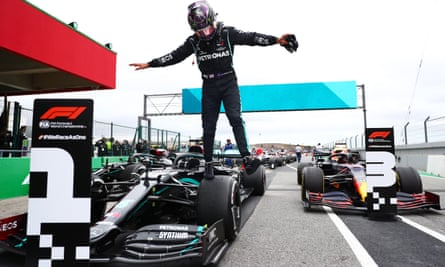 Lewis Hamilton leaps out of his car after his record-breaking 92nd Formula One  race win in Portugal.