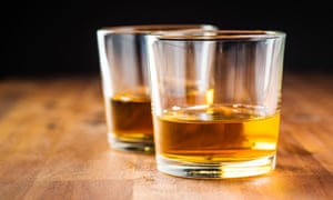 glasses of whiskey on a wooden table